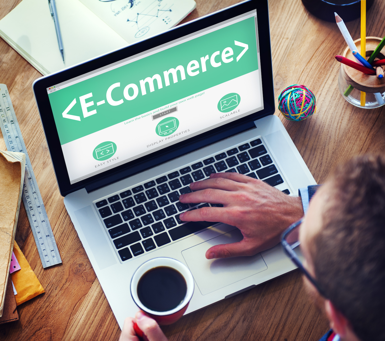 Man Using a Computer | B2B Ecommerce: 9 Tips To Help Execute Your Strategy
