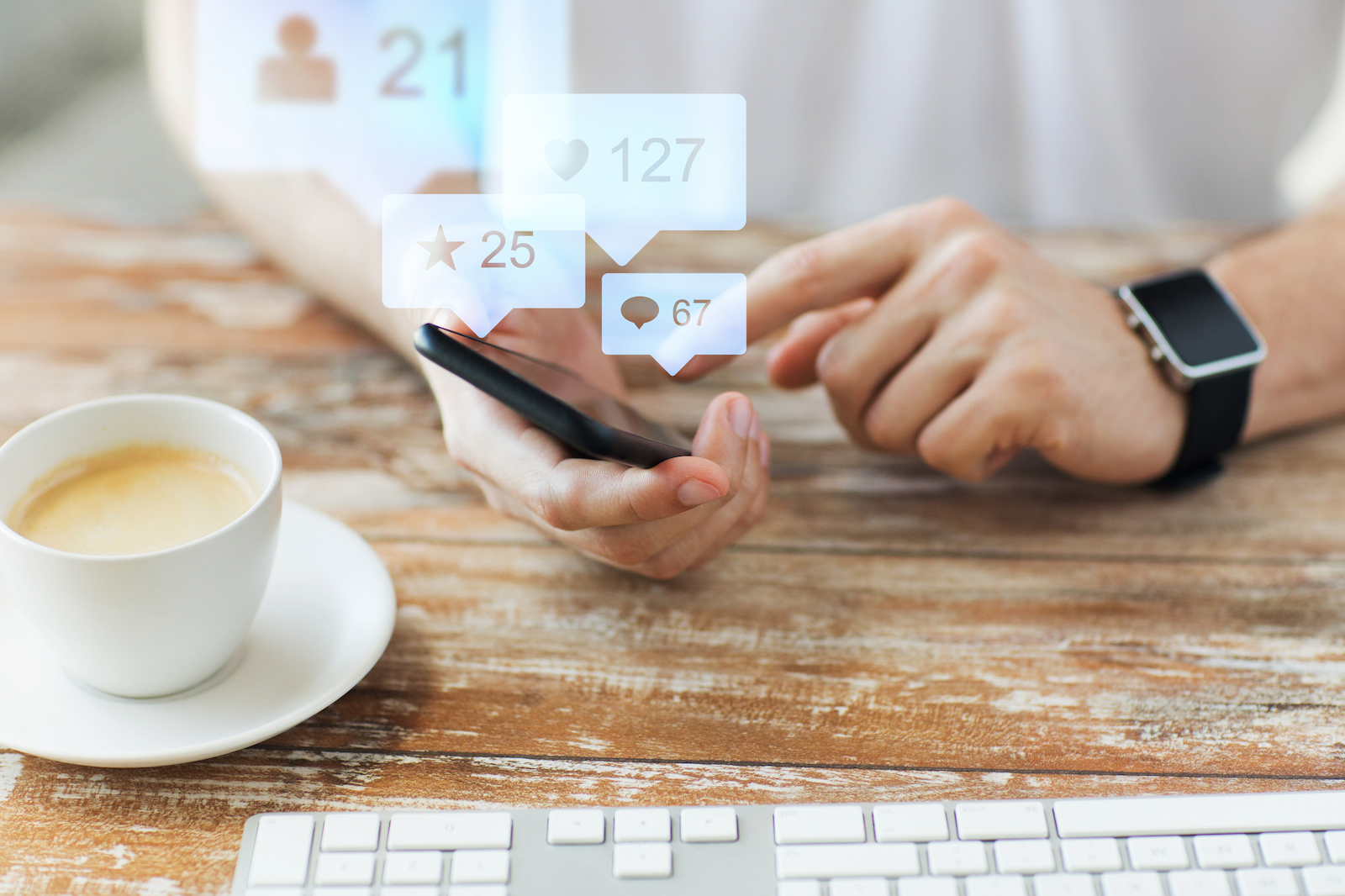 Man Using Mobile Phone   7 Tangible Business Benefits of Social Media Marketing