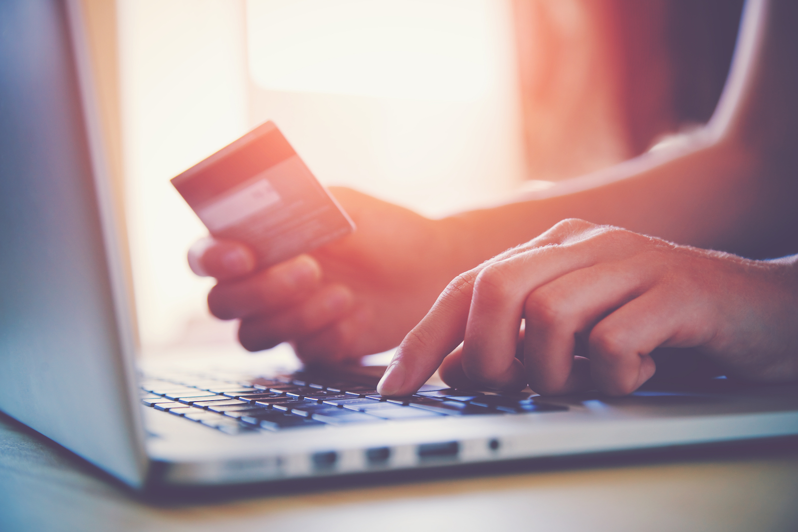Laptop and Debit Card | Ecommerce Website Builder: Easy Guide To Launching A Site
