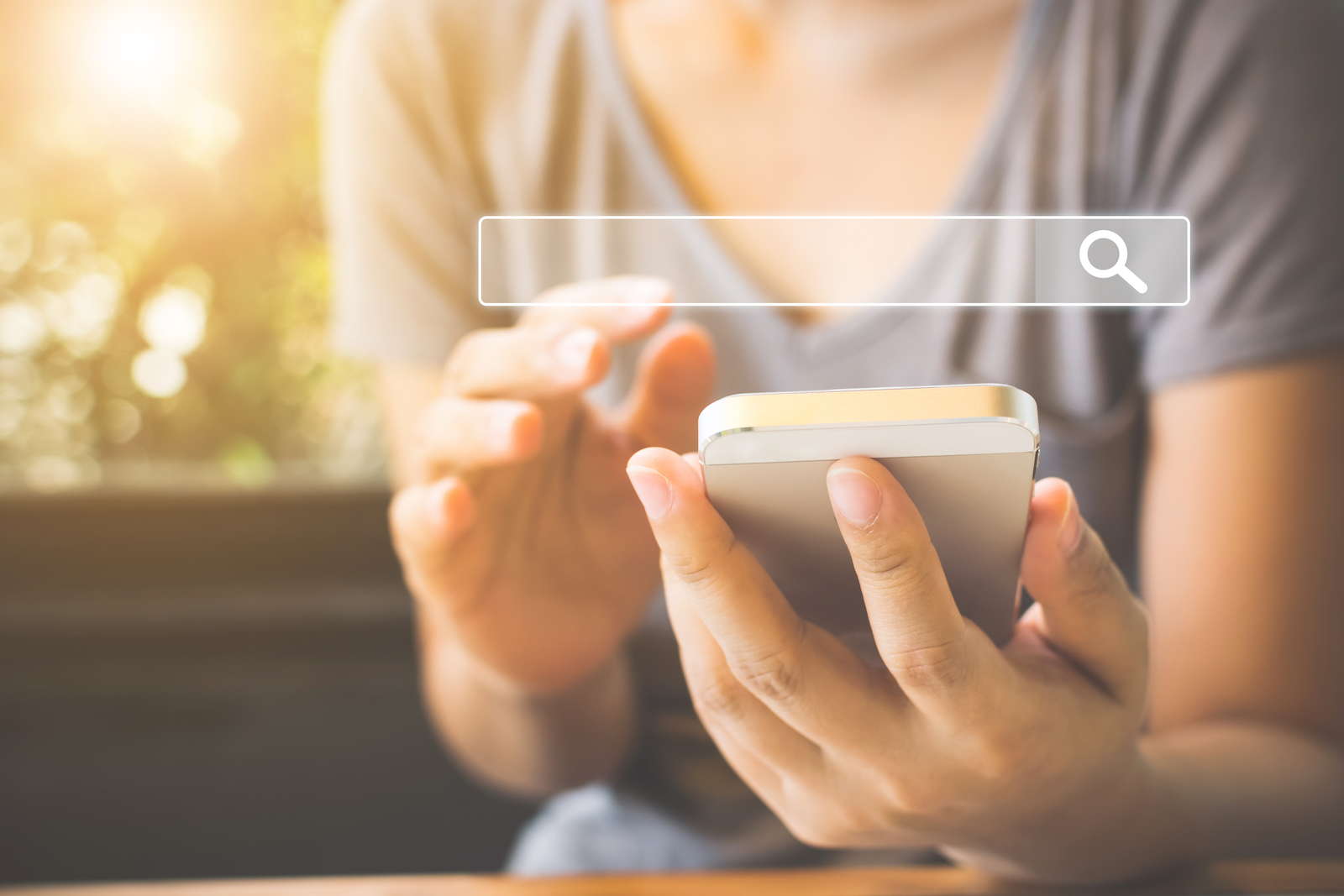 Woman Using a Mobile Phone | How To Master Local SEO With These 9 Easy Tips & Tricks