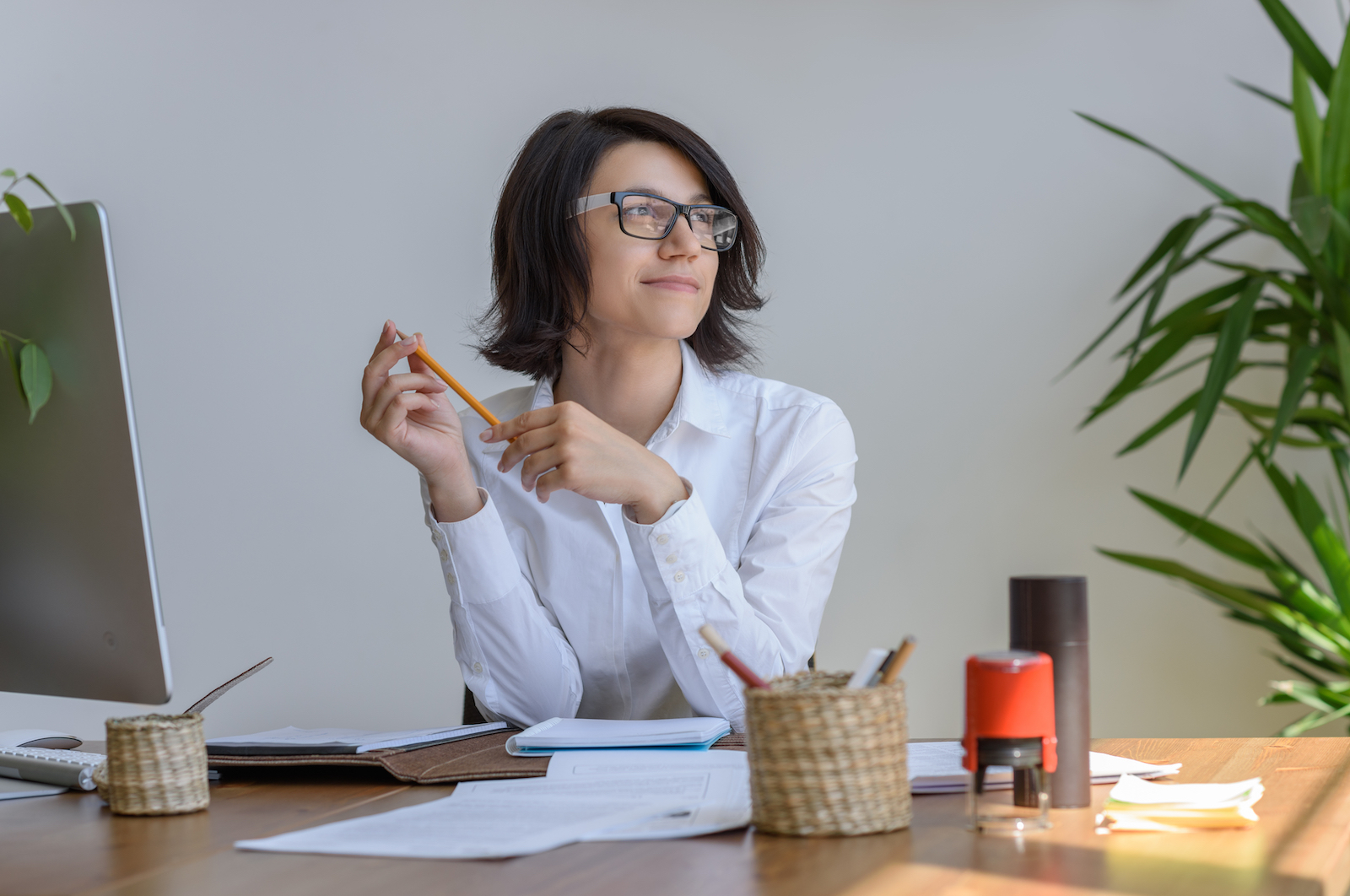 Woman In Office | 8 Extremely Useful (Some Free) Social Media Marketing Tools