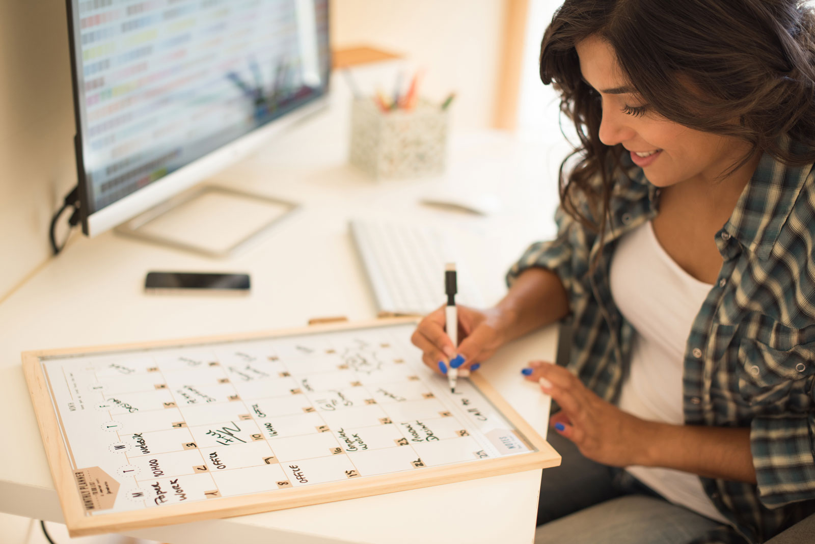 Woman Writing On A Calendar | Social Media Content: 5 Types That Get Massive Engagement