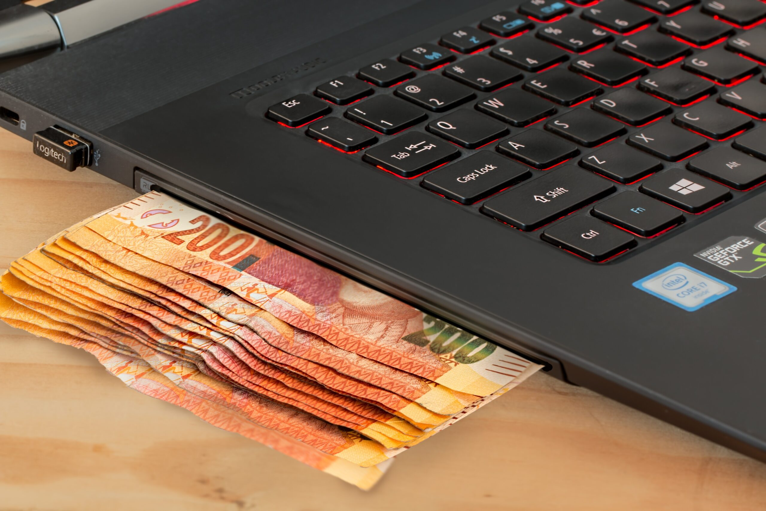 Laptop and Money | A Comprehensive Guide To Online Paid Advertising
